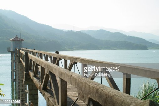 A jetty stretches out over a fresh water lake in China. : Stock Photo