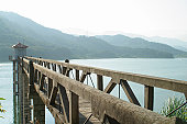 A jetty stretches out over a fresh water lake in China.