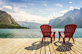 Jetty with chairs by Minnewanka Lake, Banff National Park, Alberta, Canada