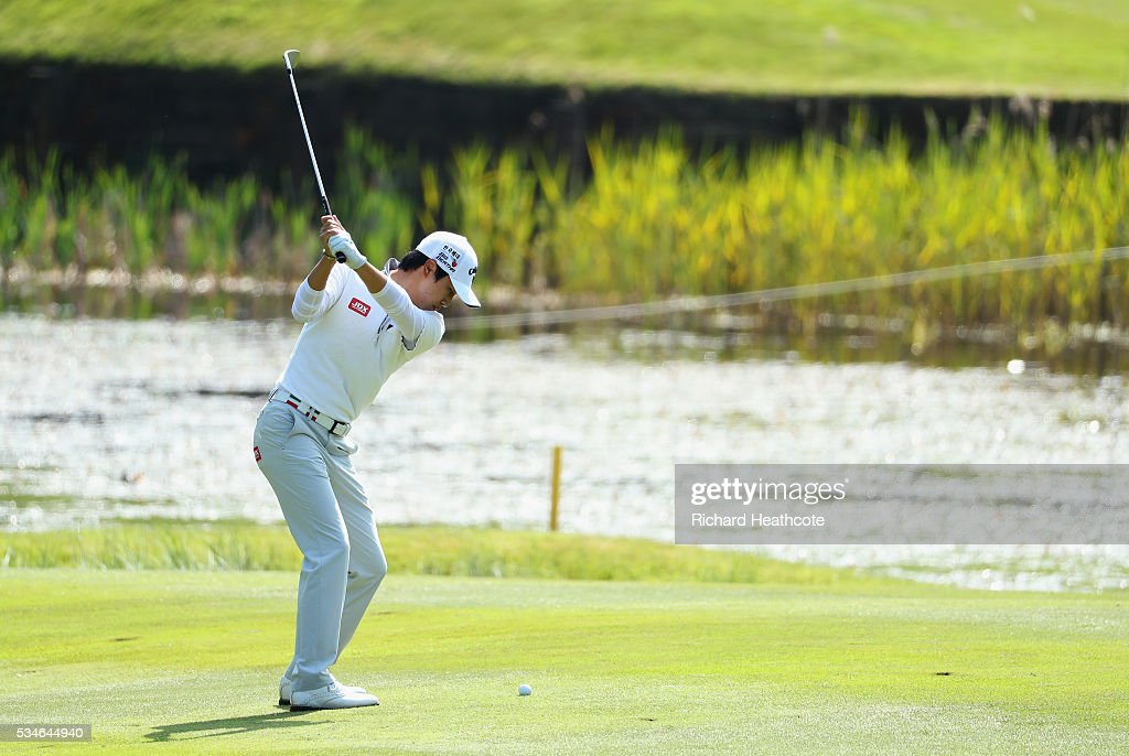 Jeunghun Wang of China hits his 2nd shot on the 8th hole during day two of the BMW PGA Championship at Wentworth on May 27, 2016 in Virginia Water, England.
