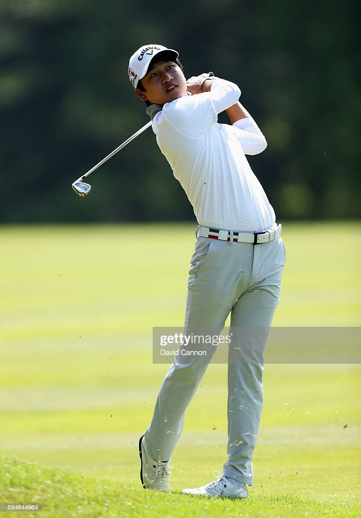 Jeunghun Wang of China hits his 2nd shot on the 9th hole during day two of the BMW PGA Championship at Wentworth on May 27, 2016 in Virginia Water, England.