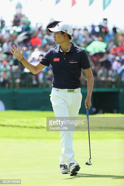 Jeunghun Wang of Korea celebrates a birdie on the 18th green during the third round of the Nedbank Golf Challenge at the Gary Player CC on November...