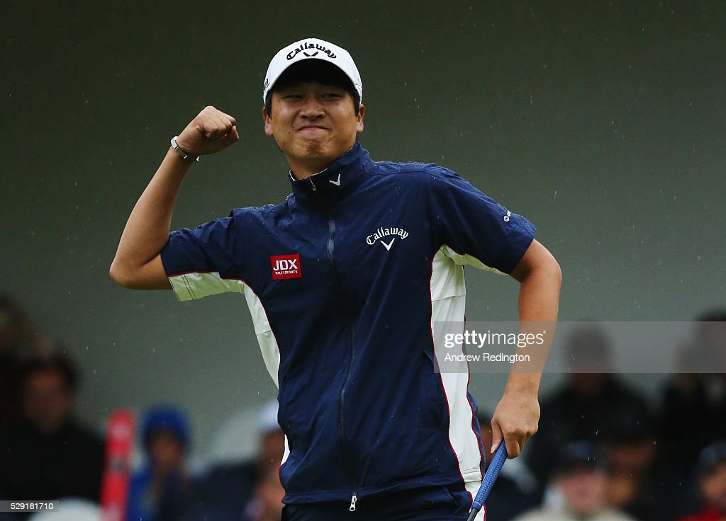 Jeunghun Wang of Korea celebrates the winning putt on the second hole of the play off with Nacho Elvira of Spain during the fourth and final round of...