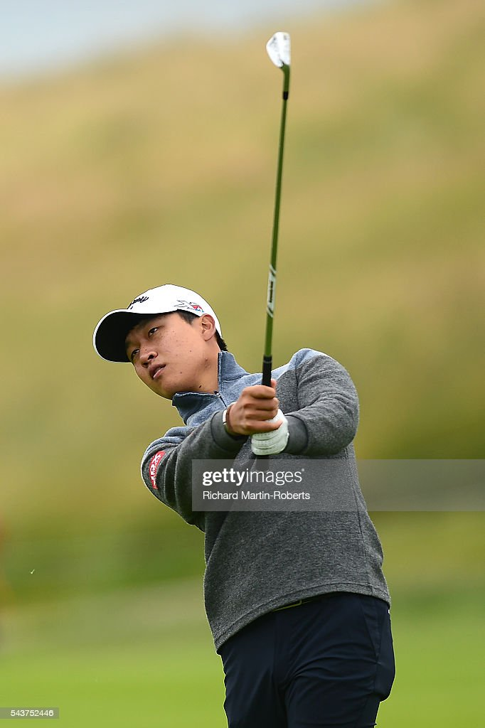 Jeunghun Wang of Korea hits a approach shot during the first round of the 100th Open de France at Le Golf National on June 30, 2016 in Paris, France.