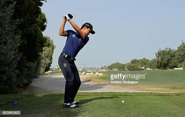Jeunghun Wang of Korea hits his teeshot on the tenth hole during the third round of the Commercial Bank Qatar Masters at Doha Golf Club on January 28...