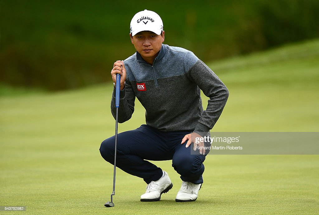 Jeunghun Wang of Korea lines up a putt on the 14th green during the first round of the 100th Open de France at Le Golf National on June 30, 2016 in Paris, France.