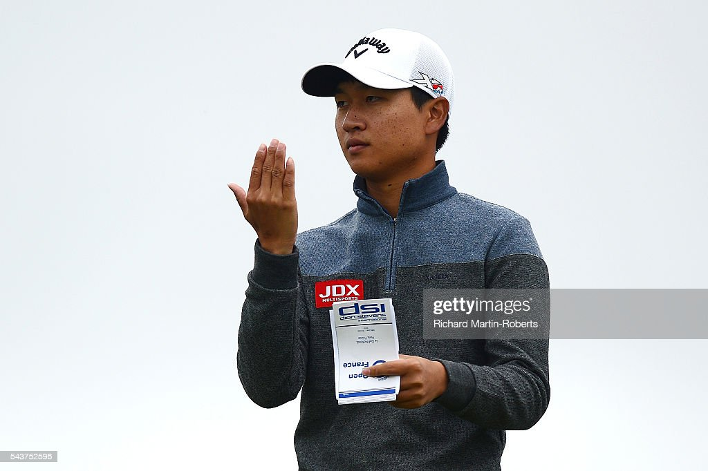 Jeunghun Wang of Korea lines up his tee shot on the 13th hole during the first round of the 100th Open de France at Le Golf National on June 30, 2016 in Paris, France.