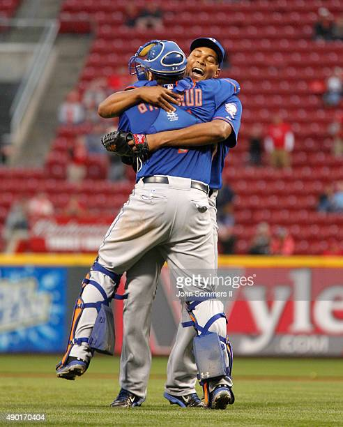 Jeurys Familia and Travis d'Amaud of the New York Mets celebrate after defeating the Cincinnati Reds 102 to clinch the National League East...