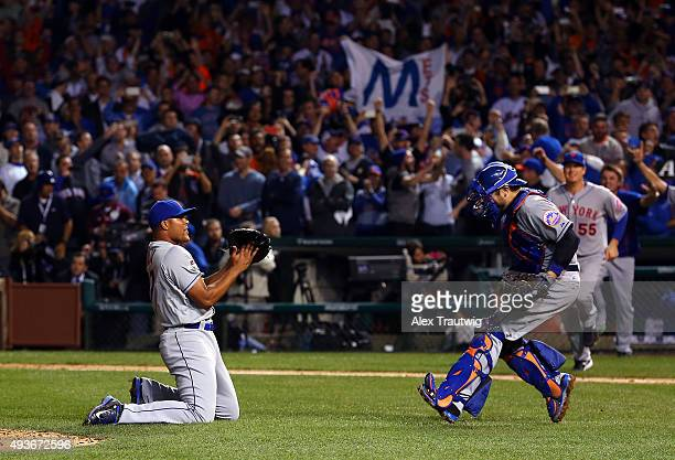 Jeurys Familia and Travis d'Arnaud of the New York Mets celebrate after winning Game 4 of the NLCS against the Chicago Cubs at Wrigley Field on...