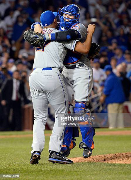 Jeurys Familia and Travis d'Arnaud of the New York Mets celebrate after defeating the Chicago Cubs in Game 4 of the NLCS at Wrigley Field on...