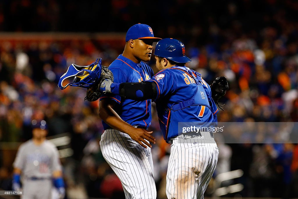 <a gi-track='captionPersonalityLinkClicked' href=/galleries/search?phrase=Jeurys+Familia&family=editorial&specificpeople=8992911 ng-click='$event.stopPropagation()'>Jeurys Familia</a> #27 and Travis d'Arnaud #7 of the New York Mets reacts celebrate after defeating the Chicago Cubs by a score outfield 4-2 to win game one of the 2015 MLB National League Championship Series at Citi Field on October 17, 2015 in the Flushing neighborhood of the Queens borough of New York City.