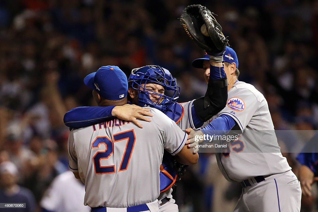 Jeurys Familia #27, Kelly Johnson #55 and Travis d'Arnaud #7 of the New York Mets celebrate after defeating the Chicago Cubs in game four of the 2015 MLB National League Championship Series at Wrigley Field on October 21, 2015 in Chicago, Illinois. The Mets defeated the Cubs with a score of 8 to 3 to sweep the Championship Series.
