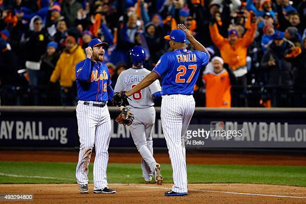 Jeurys Familia of the New York Mets celebrates the final out with Daniel Murphy after defeating the Chicago Cubs in game two of the 2015 MLB National...