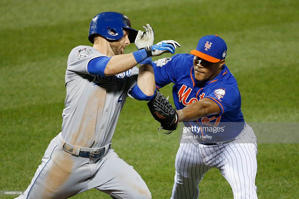 Jeurys Familia of the New York Mets tags out Alex Gordon of the Kansas City Royals during Game Five of the 2015 World Series between the Kansas City...