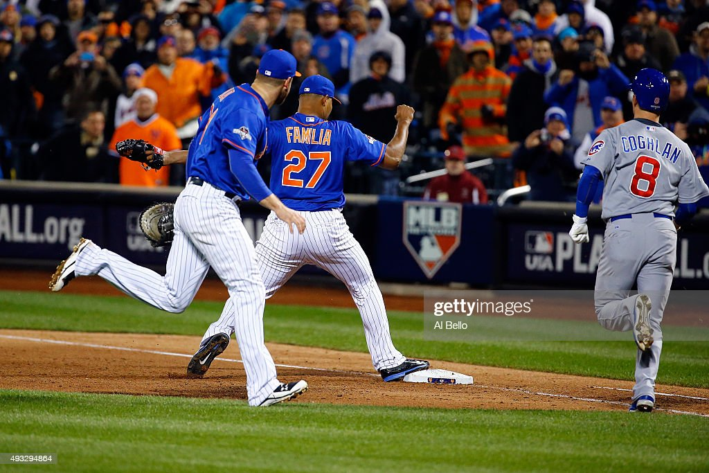 Jeurys Familia #27 of the New York Mets tags out Chris Coghlan #8 of the Chicago Cubs for the final out to defeat the Chicago Cubs in game two of the 2015 MLB National League Championship Series at Citi Field on October 18, 2015 in the Flushing neighborhood of the Queens borough of New York City. The Mets defeated the Cubs with a score of 4 to 1.