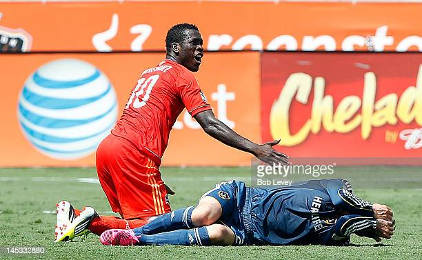 JeVaughn Watson of the Houston Dynamo pleads his case as David Beckham of the Los Angeles Galaxy lays on the grass in pain in the second half at BBVA...