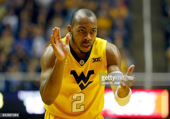 Jevon Carter of the West Virginia Mountaineers celebrates after hitting a three pointer against the Texas Tech Red Raiders at the WVU Coliseum on...