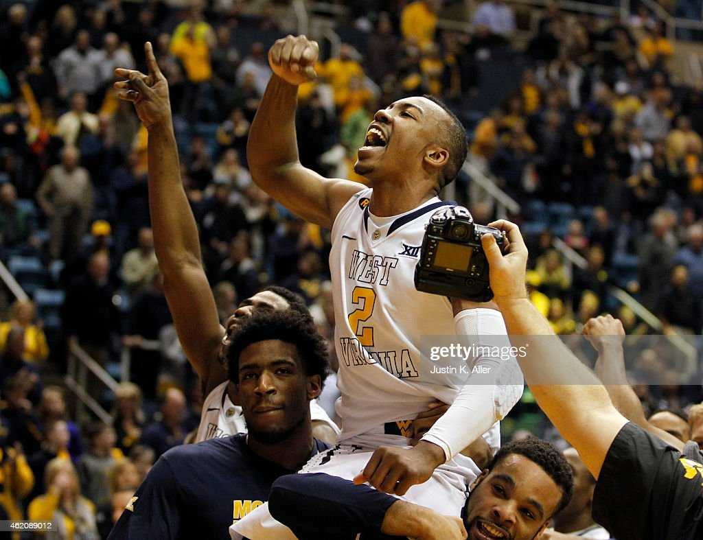 Jevon Carter of the West Virginia Mountaineers celebrates while being carried off the court by teammates after defeating TCU Horned Frogs 8685 in...