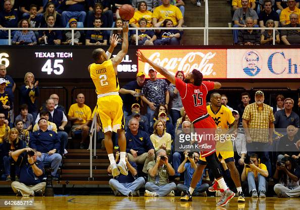 Jevon Carter of the West Virginia Mountaineers pulls up for a three against Aaron Ross of the Texas Tech Red Raiders at the WVU Coliseum on February...