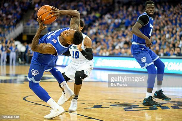 Jevon Thomas of the Seton Hall Pirates keeps the ball away from Maurice Watson Jr #10 of the Creighton Bluejays during their game at the CenturyLink...