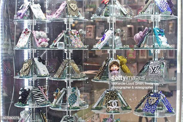 Jeweled phone cases displayed in window-display