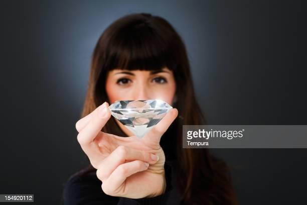 Jeweler inspecting a huge diamond _ horizontal