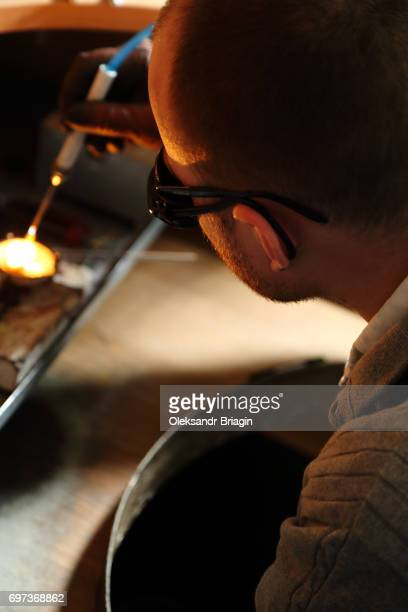 Jeweler melting precious metal