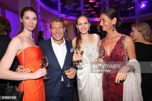 Jeweler of Juwelenschmiede Thomas Jirgens with models during the PIN Party 'Let's party 4 art' at Pinakothek der Moderne on November 18 2017 in...