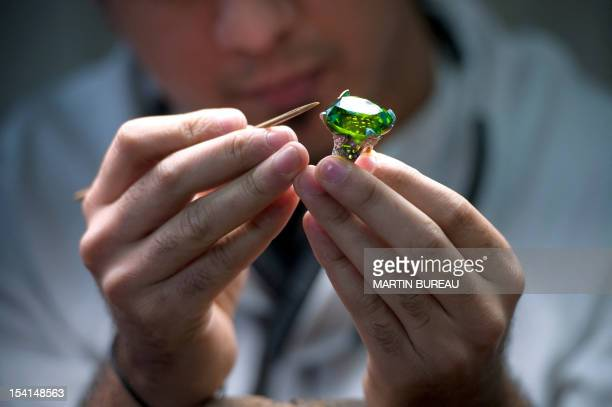A jeweler works on a piece of the French Van Cleef Arpels jewellery on January 14 2010 in the workshop of the company in ParisThe company was founded...