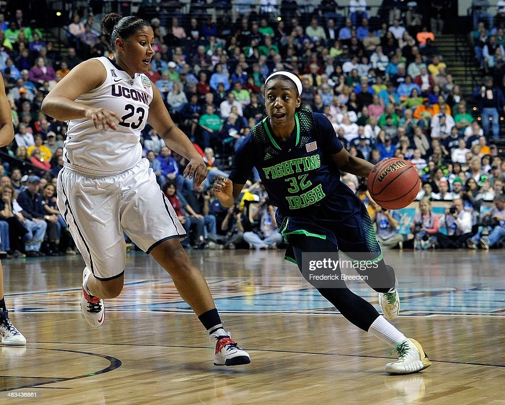 <a gi-track='captionPersonalityLinkClicked' href=/galleries/search?phrase=Jewell+Loyd&family=editorial&specificpeople=9966103 ng-click='$event.stopPropagation()'>Jewell Loyd</a> #32 of the Notre Dame Fighting Irish dribbles against Kaleena Mosqueda #23 of the Connecticut Huskies during the NCAA Women's Basketball Tournament Championship game at Bridgestone Arena on April 8, 2014 in Nashville, Tennessee.