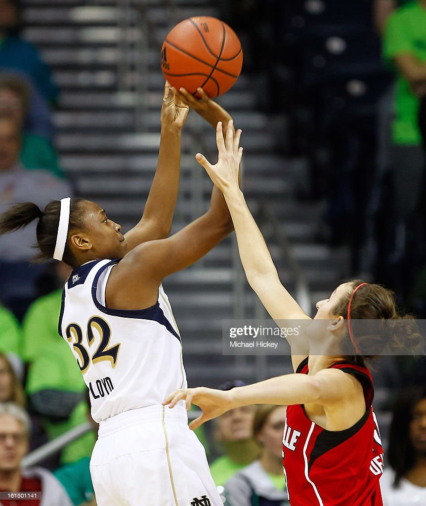Jewell Loyd #32 of the Notre Dame Fighting Irish shoots the ball over Megan Deines #15 of the Louisville Cardinals at Purcel Pavilion on February 11, 2013 in South Bend, Indiana. Notre Dame defeated Louisville 93-64.