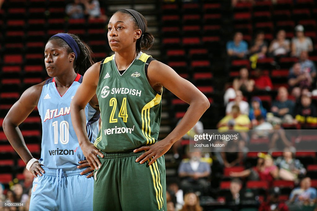 Jewell Loyd of the Seattle Storm and Matee Ajavon of the Atlanta Dream stand on the court during the game on June 28 2016 at Key Arena in Seattle...