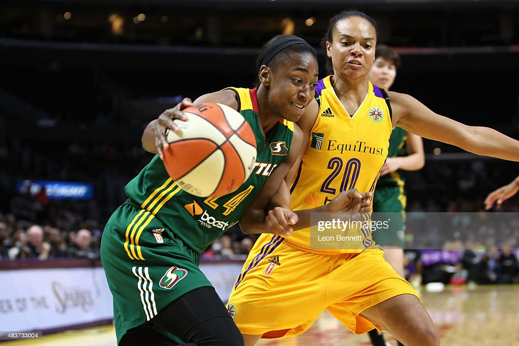 Jewell Loyd #24 of the Seattle Storm handles the ball against Kristi Toliver #20 of the Los Angeles Sparks in a WNBA game at Staples Center on August 11, 2015 in Los Angeles, California.