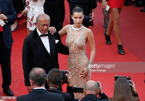 Jeweller Fawaz Gruosi and Model Bella Hadid attend the 'Cafe Society' premiere and the Opening Night Gala during the 69th annual Cannes Film Festival...