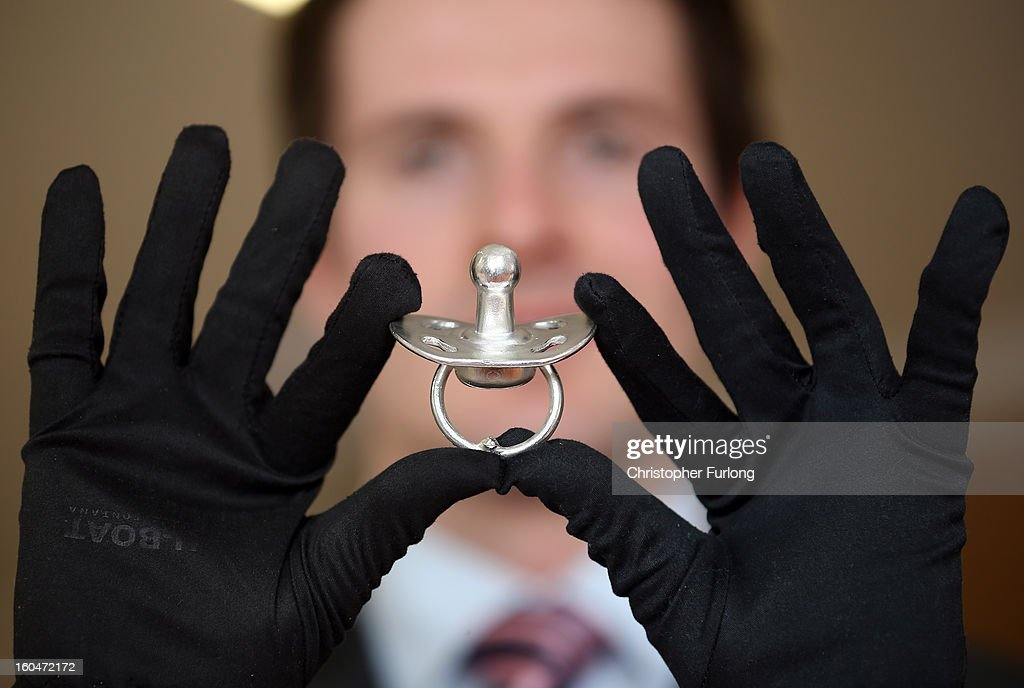 Jeweller Matt Case holds the world's most expensive dummy, valued at GBP 54,000, at bespoke jewellers Russell & Case on February 1, 2013 in Liverpool, England. The pacifier is made of pure platinum and has been created especially for the UK Baby and Toddler Show at the BT Convention Centre, Liverpool, this weekend.