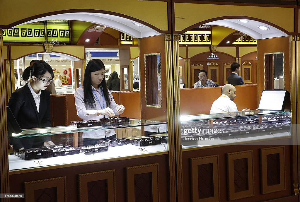 Jewellers make adjustments to their displays at the Hong Kong Jewellery and Gem Fair on June 20, 2013 in Hong Kong, Hong Kong. The June Hong Kong Jewellery & Gem Fair runs from June 20 - 23.
