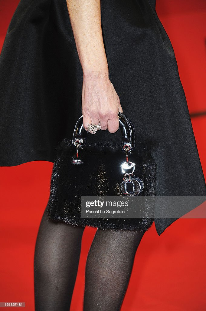 Jewellery and bag detail of actress Isabelle Huppert as she attends the 'The Nun' Premiere during the 63rd Berlinale International Film Festival at Berlinale Palast on February 10, 2013 in Berlin, Germany.