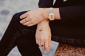 Beautiful jewelry, bracelets, watches, rings, female hands. Close-up