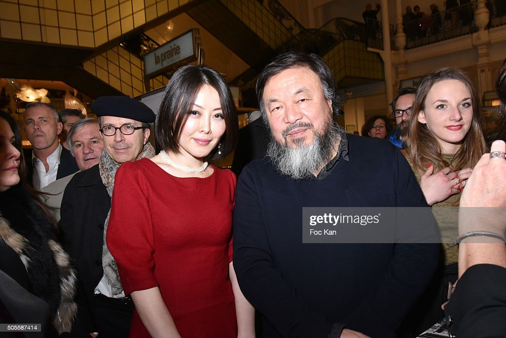 Jewellery designer Juan Yao and painter/sculptor Ai Weiwei attend the Ai Weiwei Exhibition Preview Cocktail at Le Bon Marche on January 18, 2016 in Paris, France.