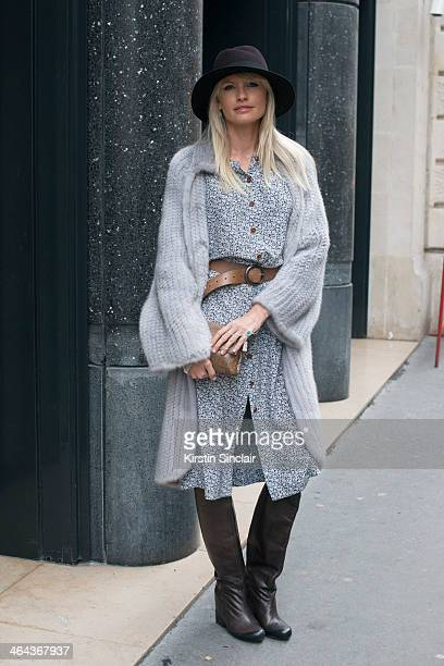 Jewellery designer Yana Raskovalova wears a Dior jacket Ulyana Sergeenko dress boots and bag and a Maison Michel hat day 2 of Paris Haute Couture...