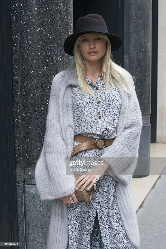 Jewellery designer Yana Raskovalova wears a Dior jacket, Ulyana Sergeenko dress and bag and a Maison Michel hat day 2 of Paris Haute Couture Fashion Week Spring/Summer 2014, on January 21, 2014 in Paris, France.