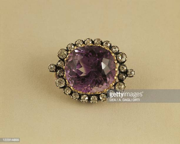 Jewellery Italy 19th century Gold and silver brooch Oval amethyst in circle of stepcut diamonds