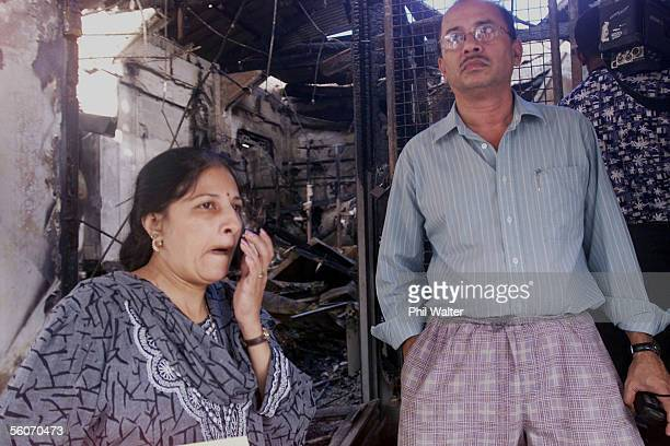 Jewellery shop owners Uruila and Jayant Lal stand at the entrance of their looted shop in the main street of Suva following the civilian coup which...