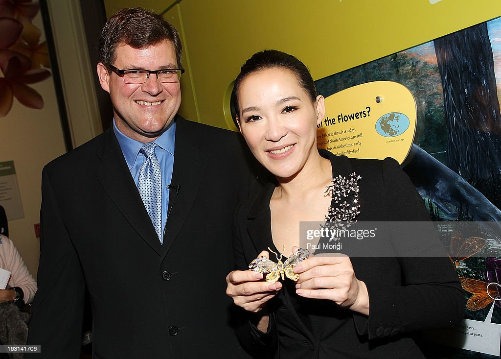 Jewelry artist Cindy Chao and Kirk Johnson, Sant Director of the National Museum of Natural History, pose for a photo during the ceremony to accession her Black Label Masterpiece Royal Butterfly Brooch into the Smithsonian's National Museum of Natural History on March 5, 2013 in Washington, DC.