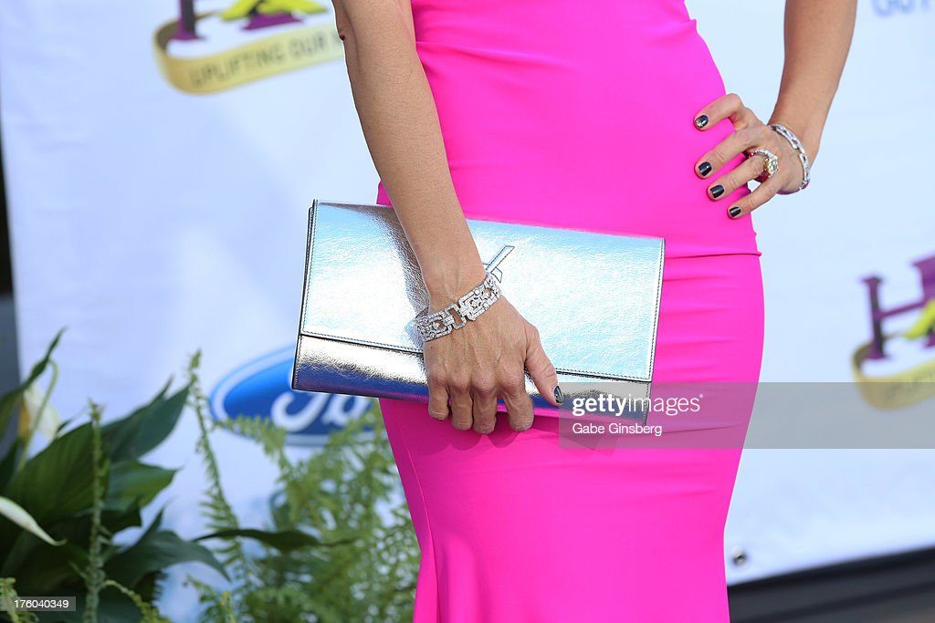 Jewelry designer Jacqueline Nerguizian (purse and bracelet details) arrives at the 11th annual Ford Neighborhood Awards at the MGM Grand Garden Arena on August 10, 2013 in Las Vegas, Nevada.