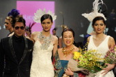 Jewelry designer Joe Polthakorn of Vilaiwan Fine Jewelry appears on the the runway with designer Sue Wong and models for the Sue Wong 'Great Gatsby'...
