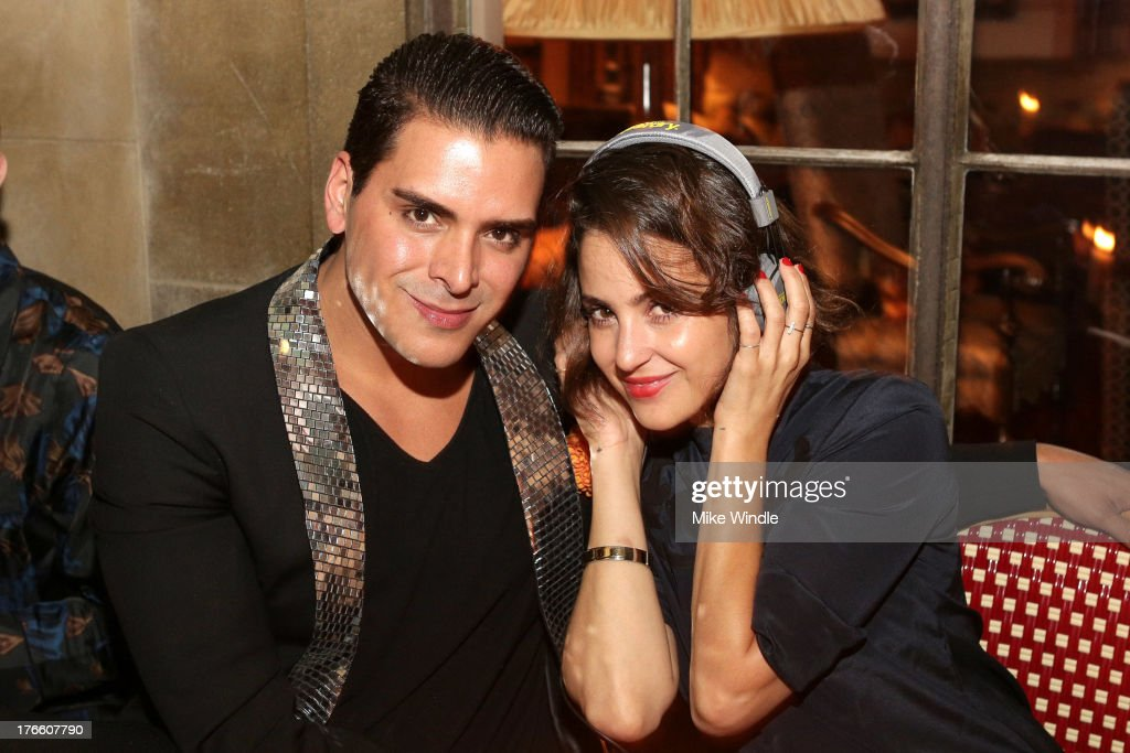 Jewelry designer Markus Molinari (L) and stylist Maya Krispin attend the SUPERDRY intimate dinner in celebration of the brand's Autumn/Winter 2013 Collection at Chateau Marmont on August 15, 2013 in Los Angeles, California.