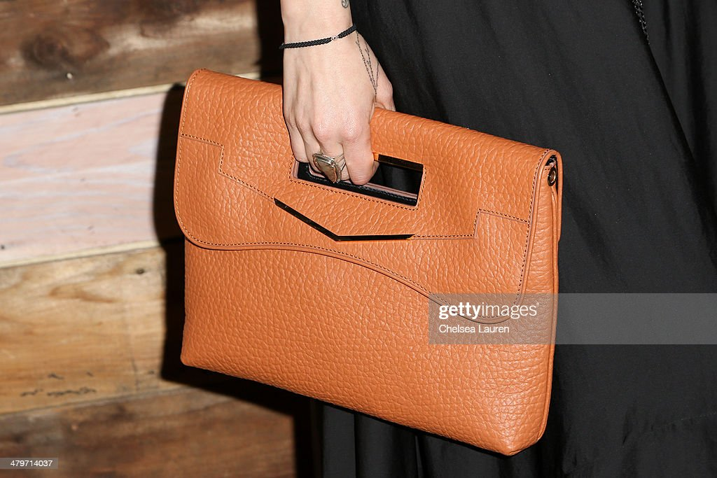 Jewelry designer <a gi-track='captionPersonalityLinkClicked' href=/galleries/search?phrase=Pamela+Love+-+Fashion+Designer&family=editorial&specificpeople=10966991 ng-click='$event.stopPropagation()'>Pamela Love</a> (clutch detail) attends H&M Conscious Exclusive Dinner at Eveleigh on March 19, 2014 in West Hollywood, California.
