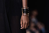 A jewelry detail is seen as a model walks the runway during the Balmain show as part of the Paris Fashion Week Womenswear Spring/Summer 2015 on...