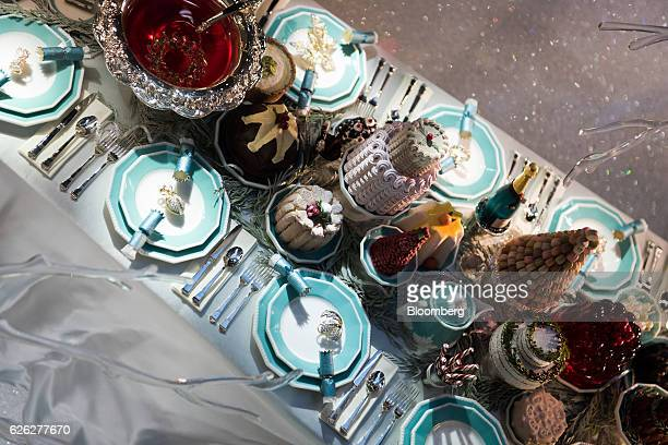 Jewelry sits on plates inside a holiday window display at the Tiffany Co flagship store on Fifth Avenue in New York US on Saturday Nov 26 2016...